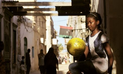A young girl kicks a football in Libya, in the documentary Freedom Fields