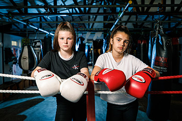 Photo of two young woman boxers with boxing gloves