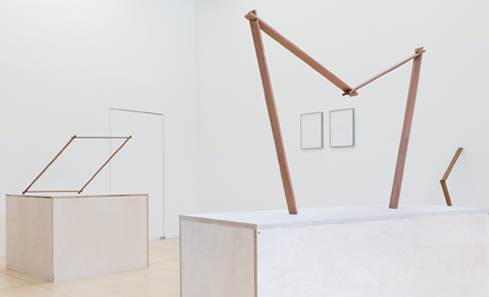 Structural and minimalist sculptures in a white walled gallery space