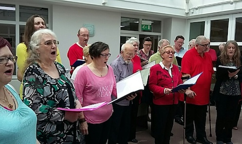 Freedom of Mind Choir perform at Strathcarron Hospice in June.