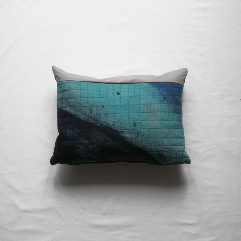 A blue and white cushion inspired by the sea
