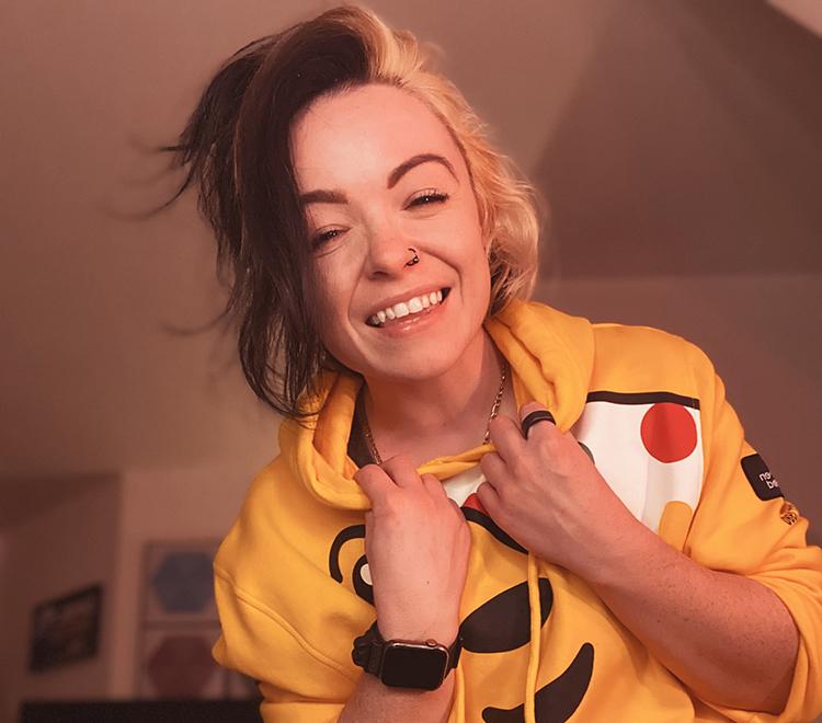 Photo of Chipzel wearing a yellow jumper