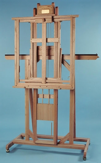 Photo of a wooden easel on a blue background