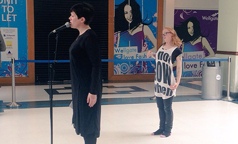 Rachel McCrum and Gemma Connell performing Flow! Dance & Poetry in Wellgate Shopping Centre