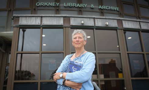 Alison Miller stands in front of the Orkney Library & Archive