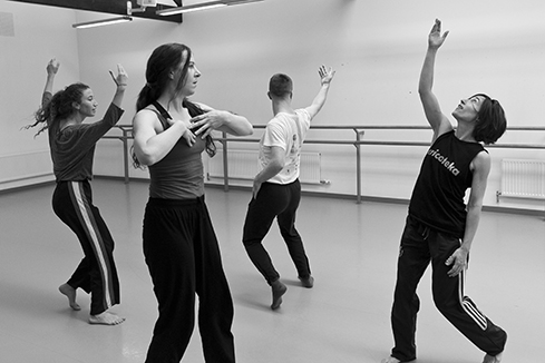 Photo of four people dancing in a studio