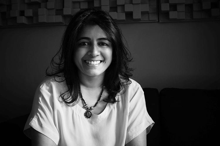 Photo of Nainita Desai in black and white