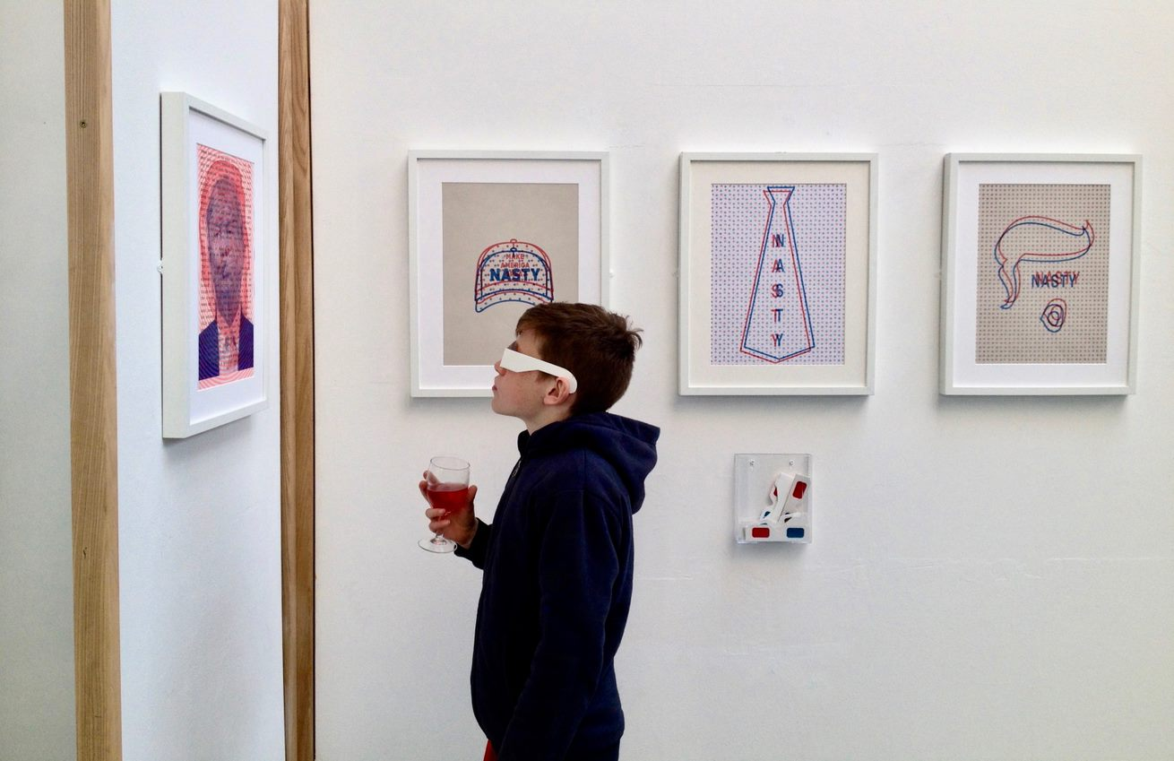 A person views a print as part of a gallery exhibition