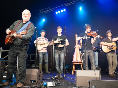 Brian McNeill's Festival Session performing at the Cambridge Folk Festival 2014. (Photo by Charles Sturman)