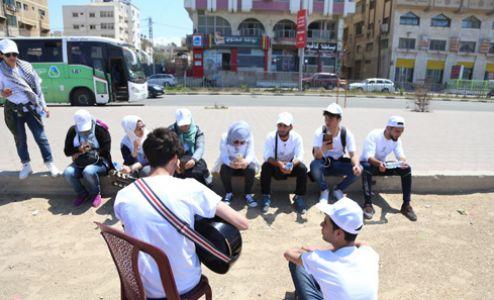 Derevon Projects - Slow Marathon 2018 - In Gaza playing guitar