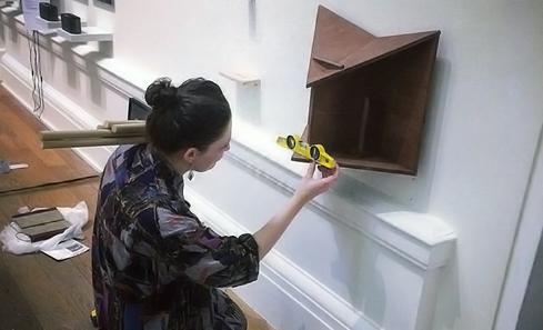 Sarah Calmus installing the Zine Stand