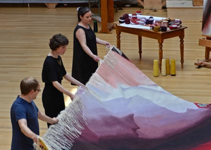 Painter Alison Watt was commissioned by Scottish Opera to design a new tapestry. Image from the cutting off ceremony in Dovecot Studios.