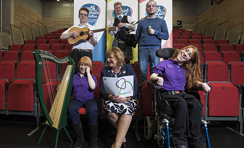 Youth Music Initiative Musicians with Cabinet Secretary Fiona Hyslop. Photo: Drew Farrell.