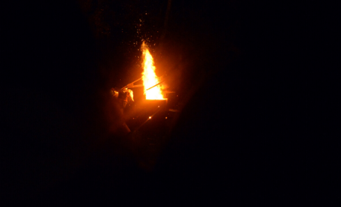 The iron kiln flame burns high and bright