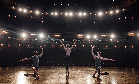 Three ballet dancers on a stage